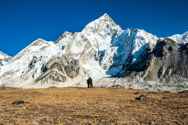 Young Couple Watching At Mount Mt. Everest And Nuptse Peak At Ka