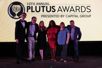 On stage at the Plutus Awards