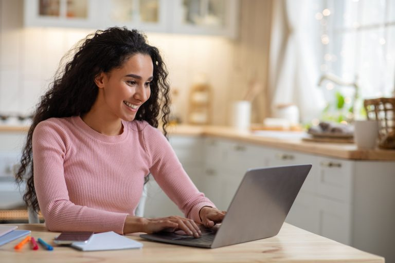 woman at laptop registering a trademark for her blog